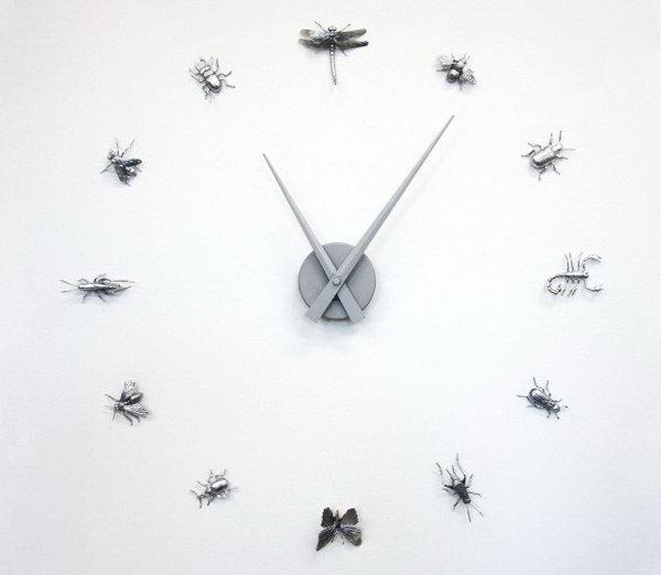 4 Curiosities Wall Clock