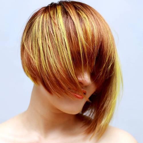 40 asymmetrical red bob with golden highlights