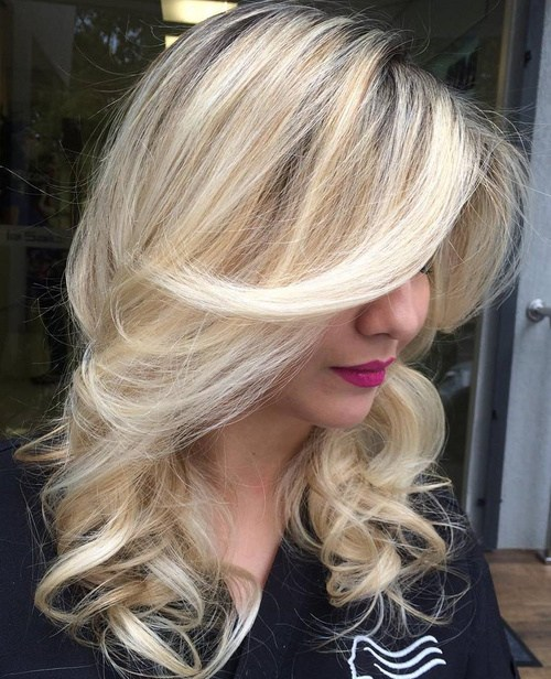 55 blonde curly layered hairstyle