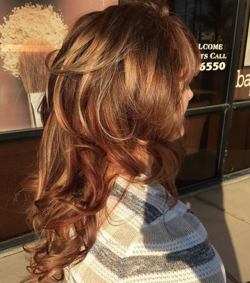 56 long layered curly hairstyle with highlights