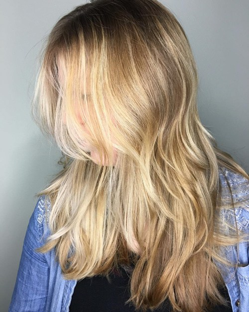 67 long blonde layered hairstyle with balayage