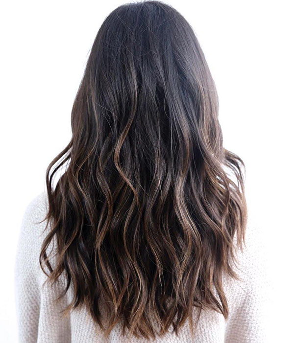 7 wavy black hair with brown balayage