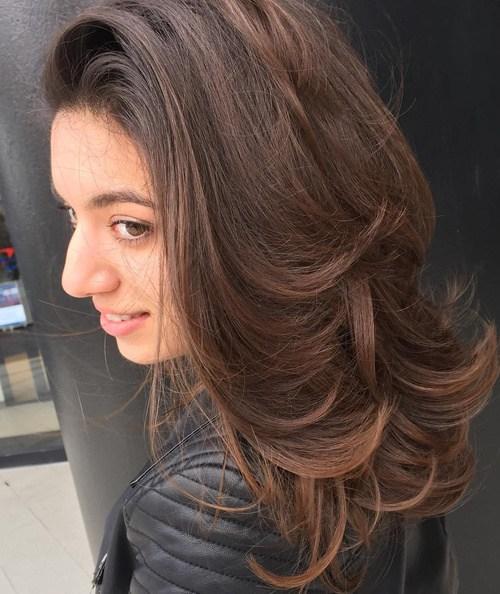 70 brunette voluminous layered hairstyle