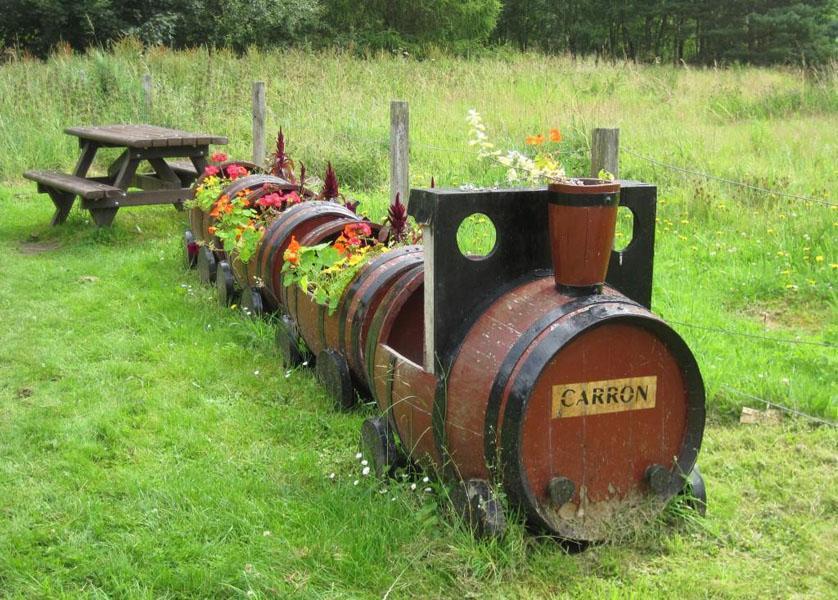 16 Barrels Transformed into Train Garden Planter