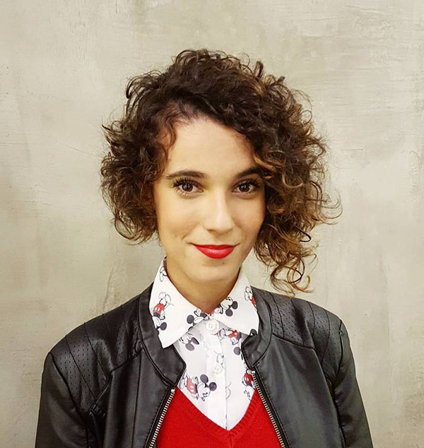 25 short asymmetrical curly hairstyle