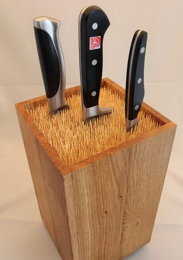10 Fill an old box with skewers to make an universal knife block