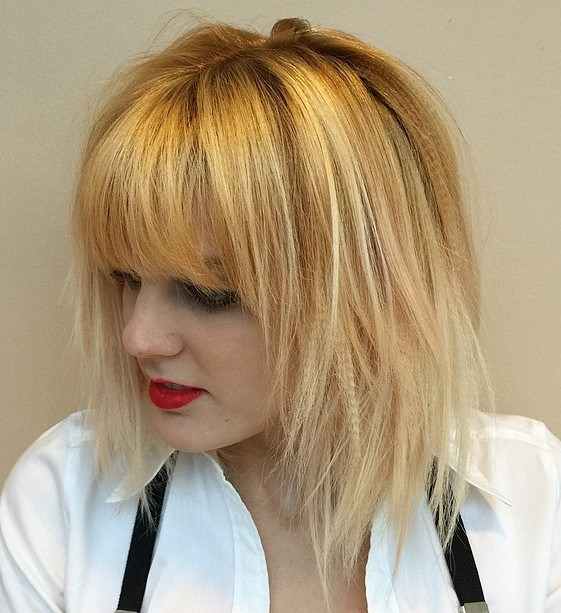 13 golden blonde layered bob with bangs