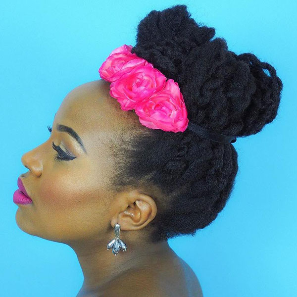 13 twisted natural updo with hair flowers