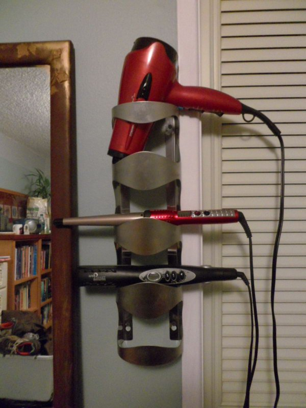 19 Turn your old wine bottle holder into a useful hot tools storage