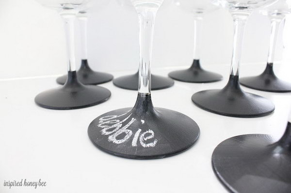 21 Use chalkboard dipped wine glasses to help distinguish whose is whose
