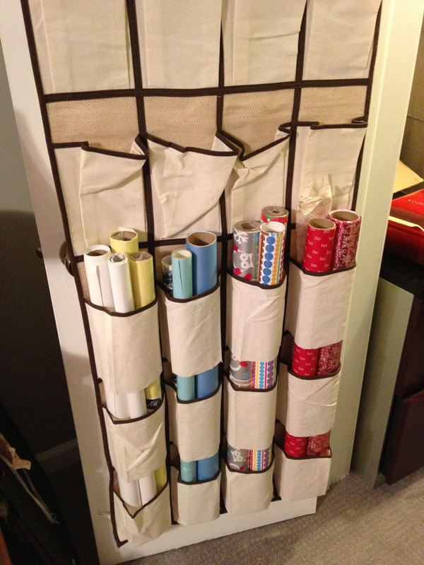 22 Cut the bottoms off the shoe pockets and use it as an organizer for wrapping paper