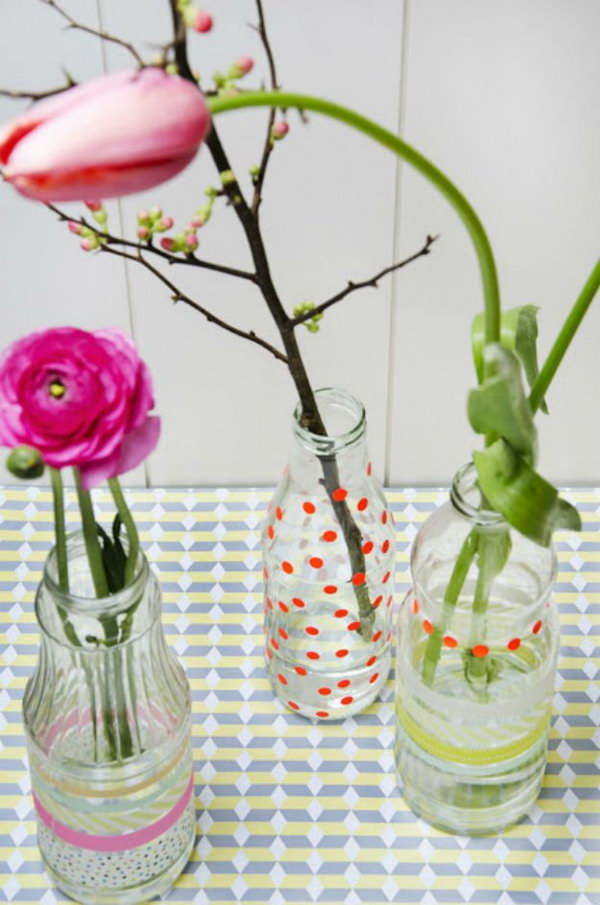 23 Create a DIY flower vase with old juice bottles colourful flowers and fancy tape