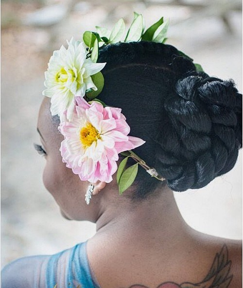 38 black twisted bun updo with hair flowers