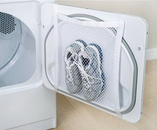 4 Tape a laundry bag to the inside of your tumble dryer door for easy drying of sports shoes