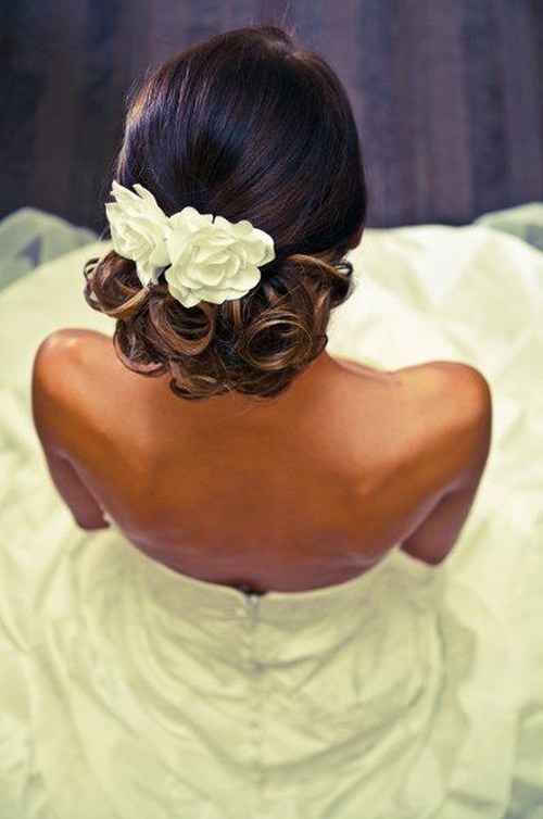 45 low updo with flowers and lovely ringlets