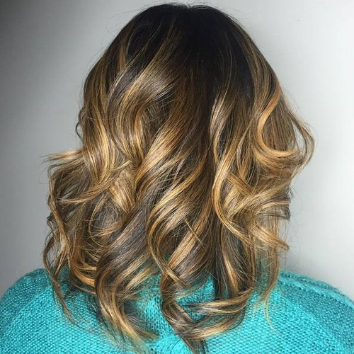 7 dark brown hair with golden blonde balayage