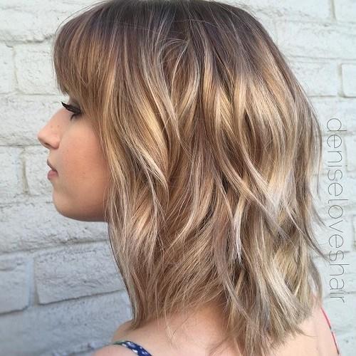 7 medium layered haircut with bangs