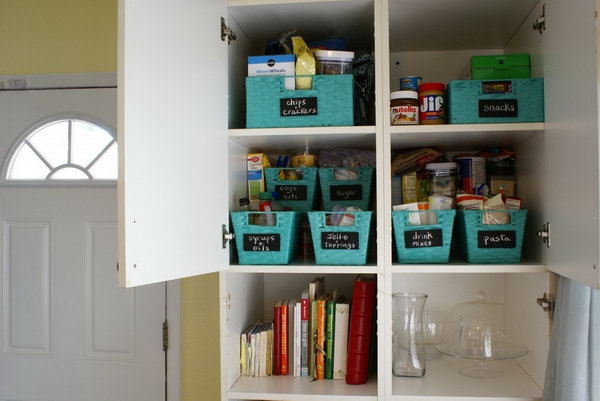 9 Use baskets with wooden chalkboard labels to organize your pantry cabinet