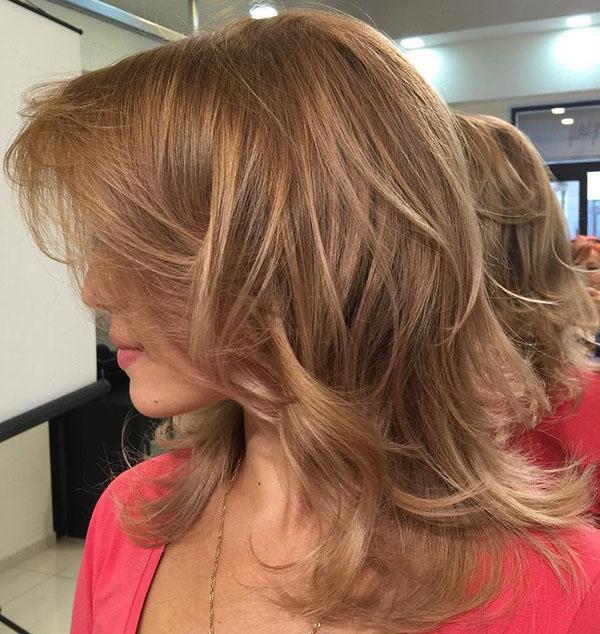 9 medium layered hairstyle with bangs