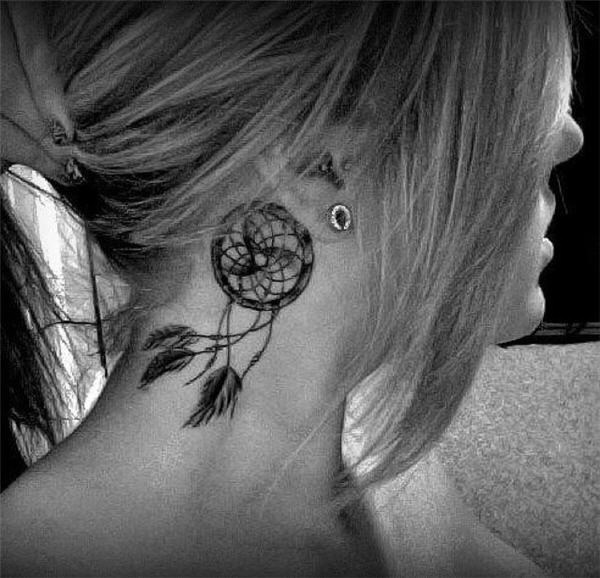 1 Delicate dreamcatcher tattoo behind the ear