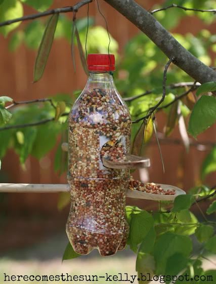 26 Make a bird feeder out of a soda bottle and two wooden spoons or dowels
