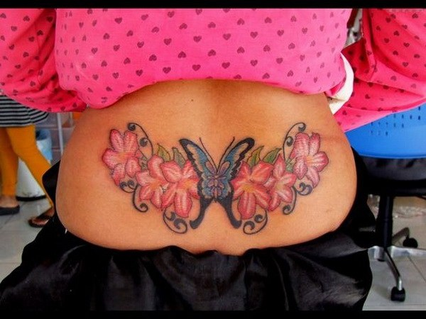21 Butterfly and Flower Tattoo On Lower Back