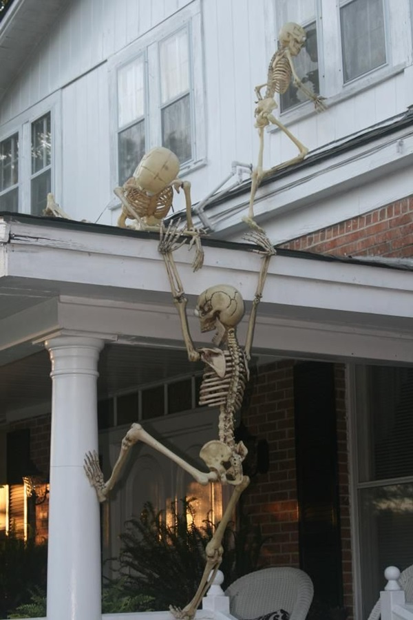 31 Skeletons Climbing Front Porch